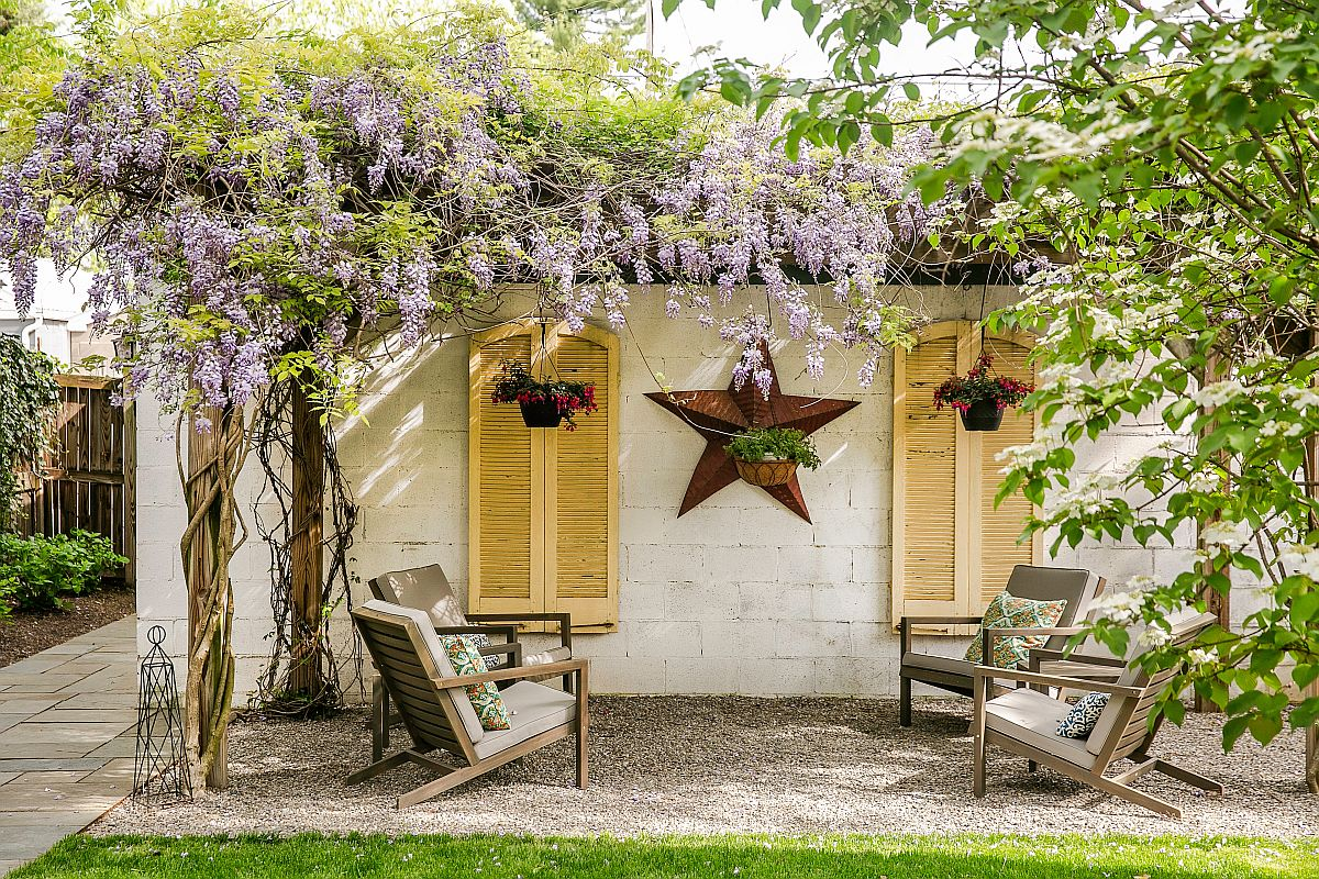 Pergola structure is entirely covered in vines giving it a dreamy, whimsical charm
