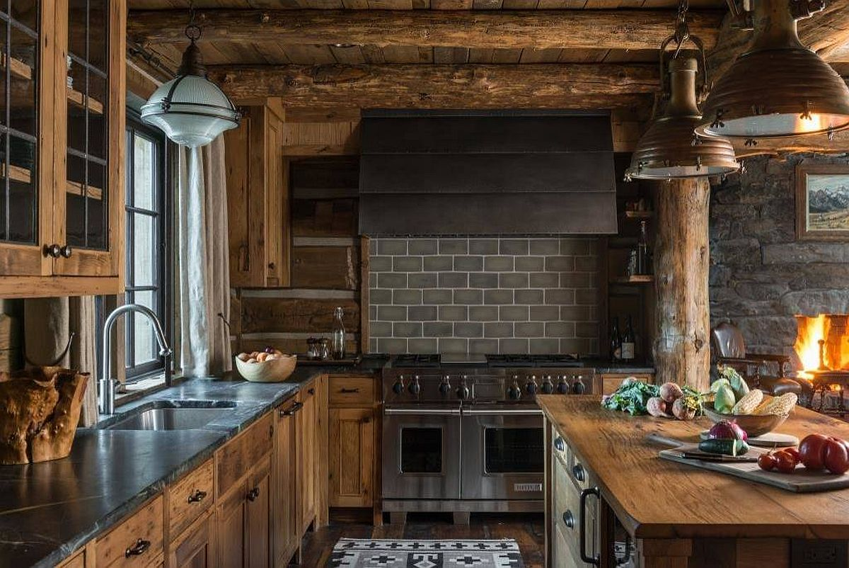 Picture-perfect rustic kitchen with a fireplace, stone coutertops and a cozy ambiance