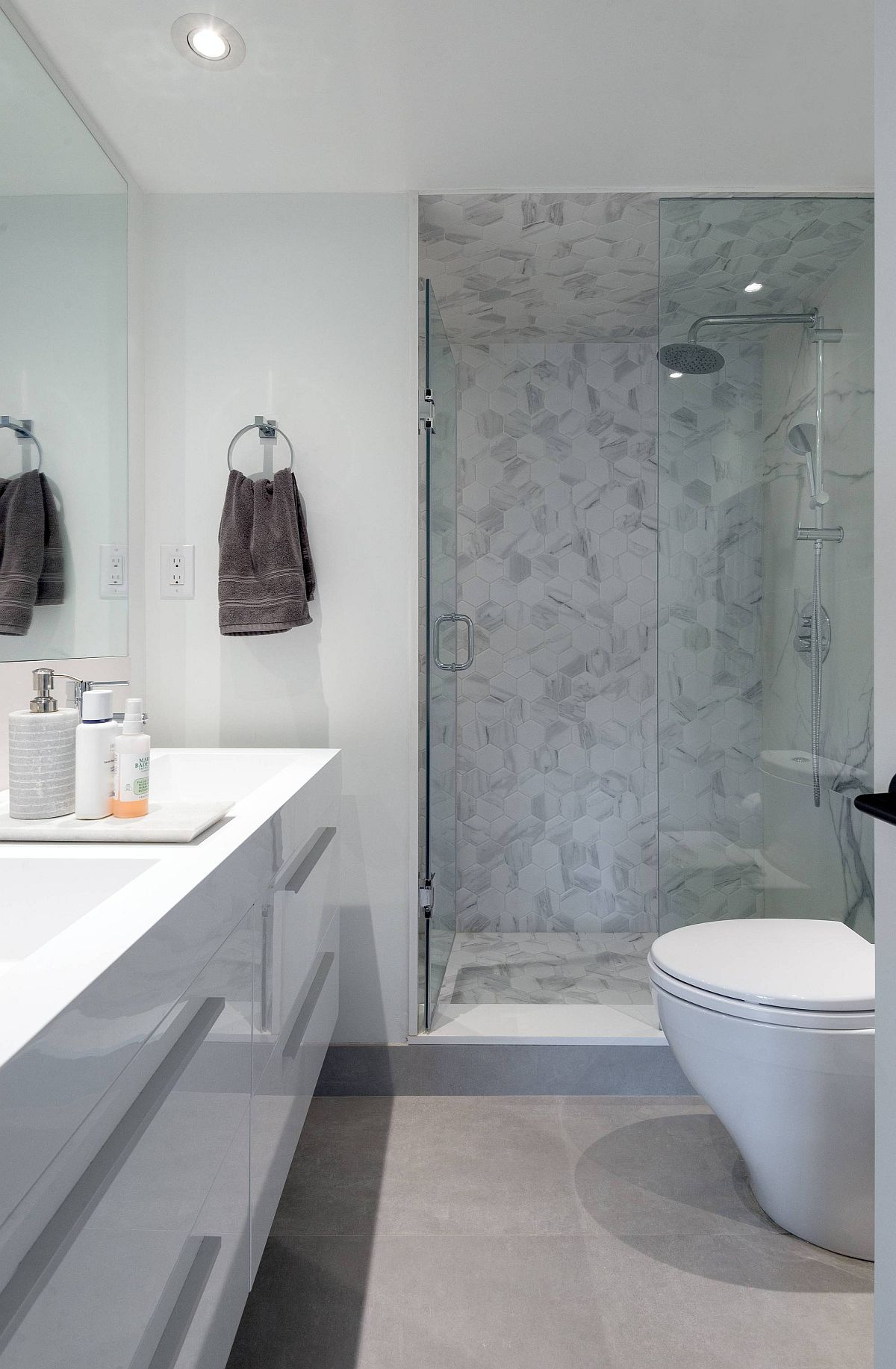 Polished contemporary bathroom of toronto home in white and gray