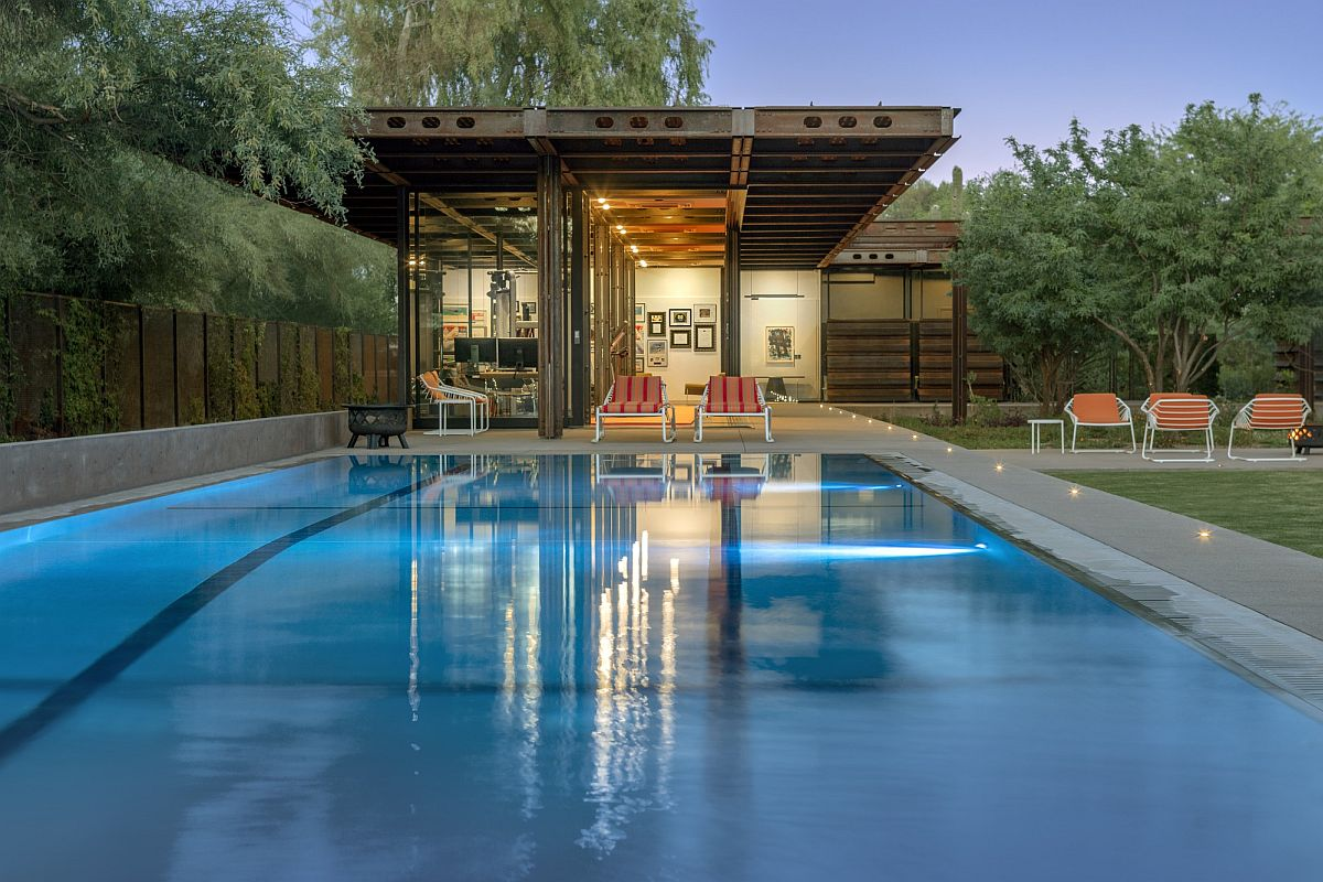 Pool house next to the lavish contemporary pool alos built using a corten steel frame
