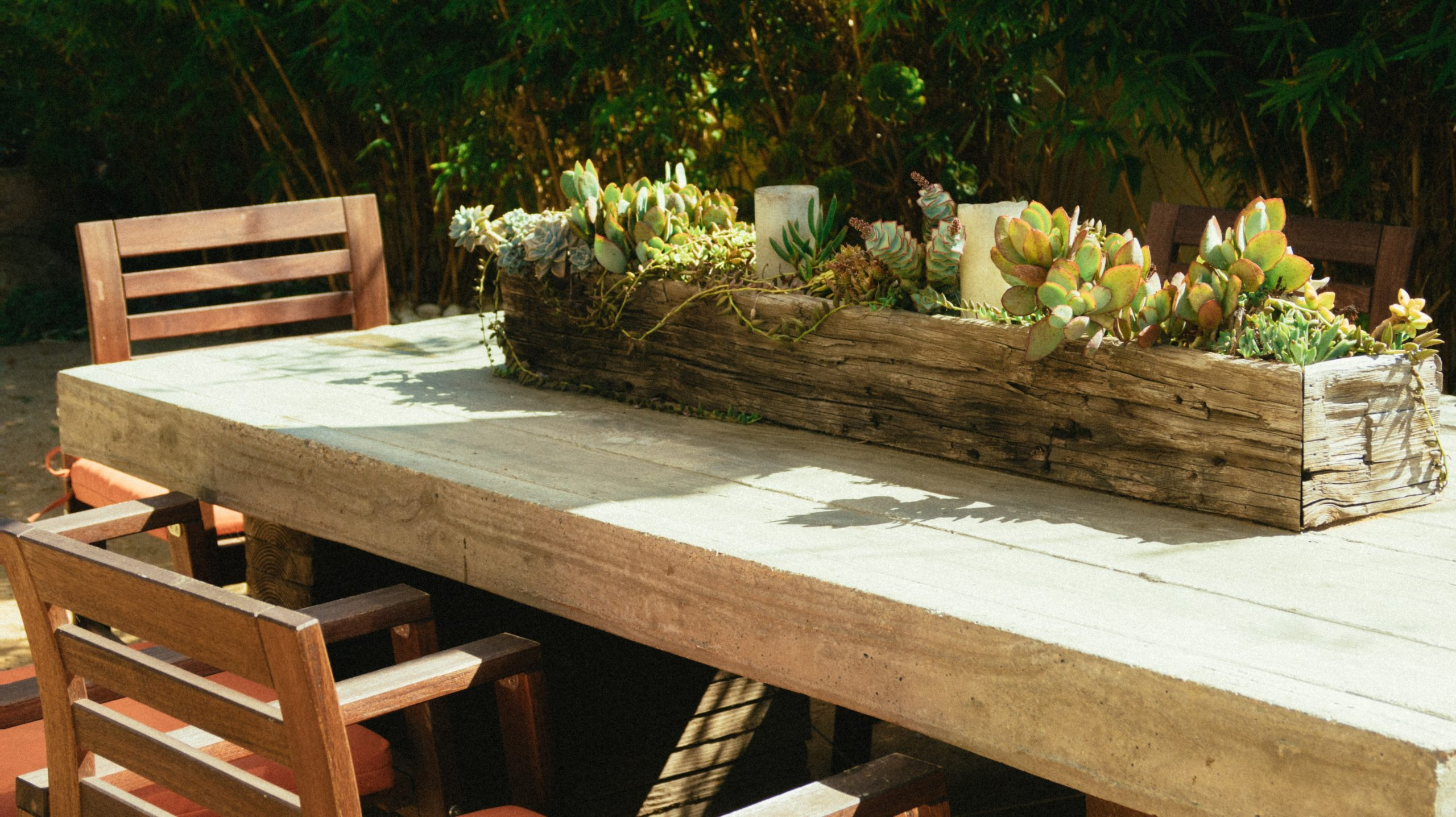 wooden plant box on outdoor table