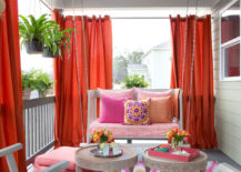 Vibrant Outdoor Space With Hanging Daybed and Draperies
