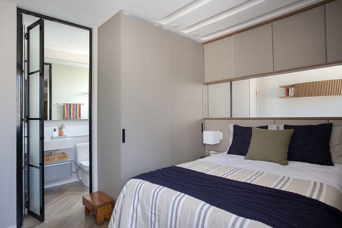 Renovated bedroom with bathroom that has a relaxing modern vibe