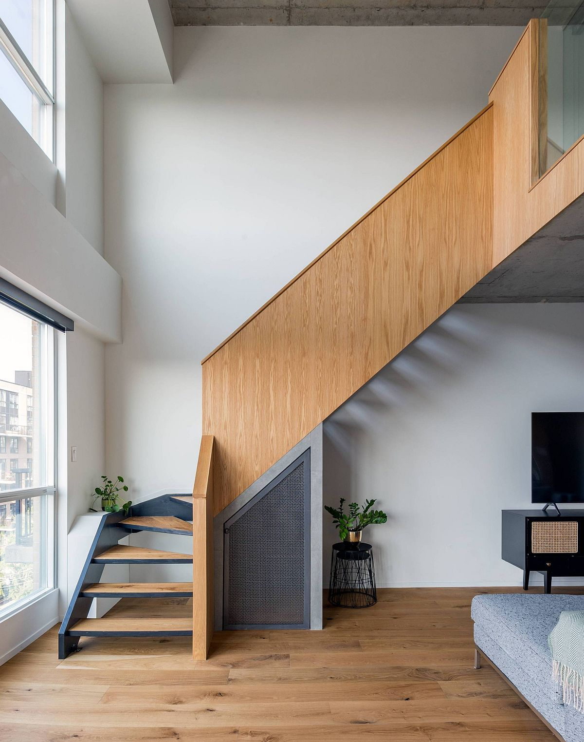 Reworked staircase inside the loft home with stained oak guard and metal steps