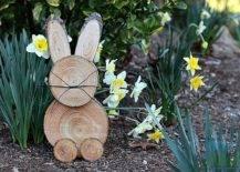Rustic wooden bunny in a garden