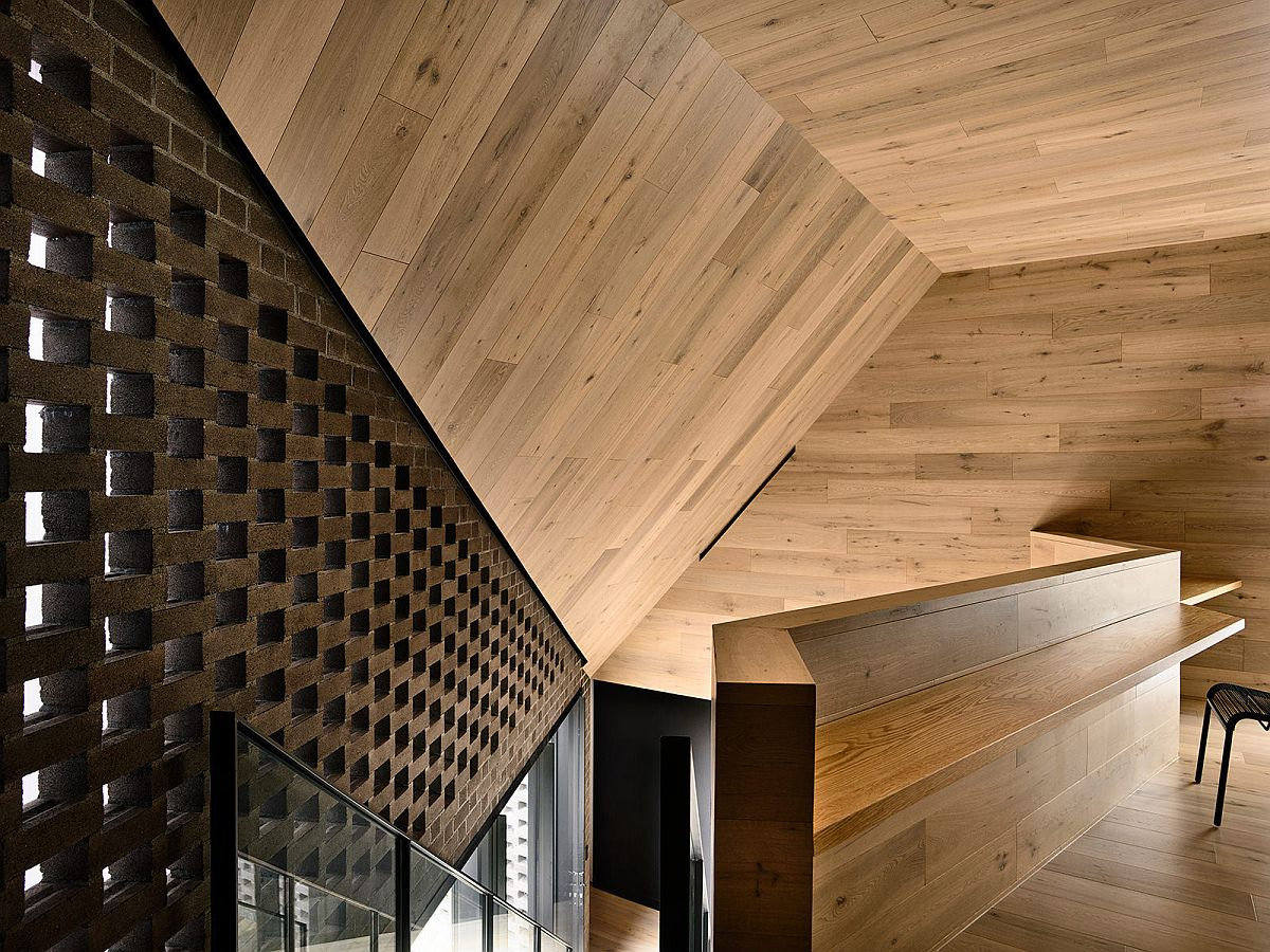 Sculptural staircase leading to the upper level with a calming study nook