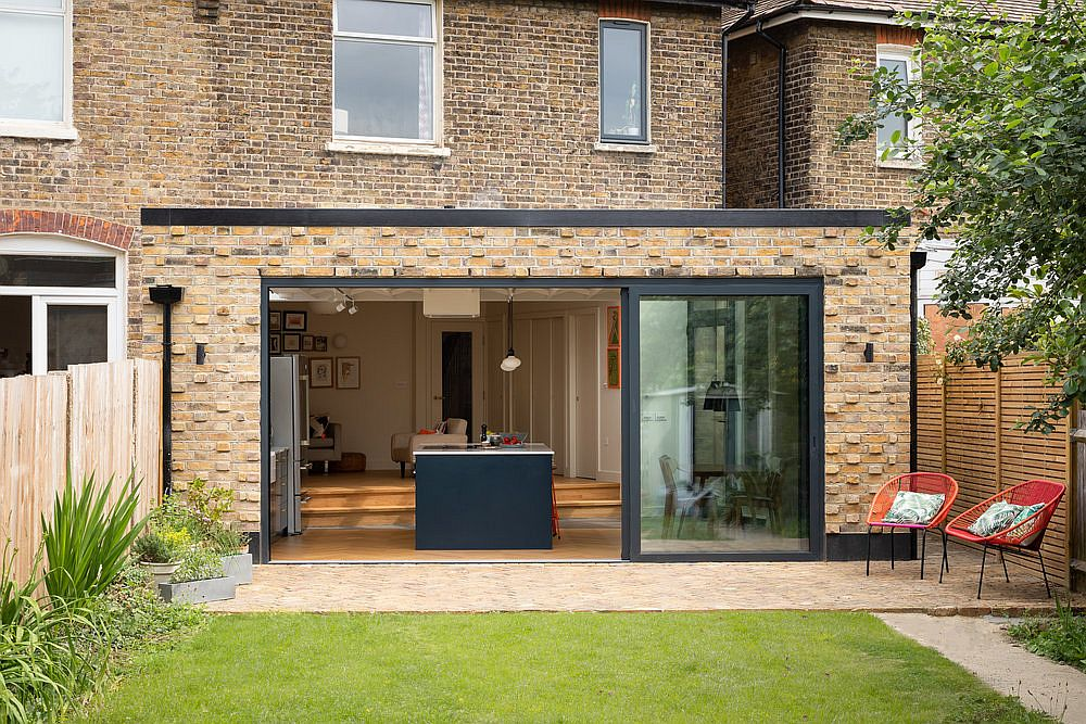 Sliding glass doors connect the kitchen with a beautiful new garden outside