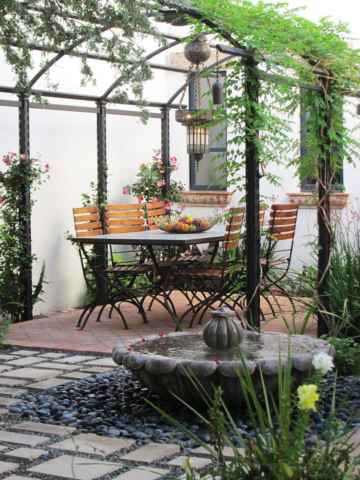 Slim pergola structure coupled with with creepers to create shade in the garden