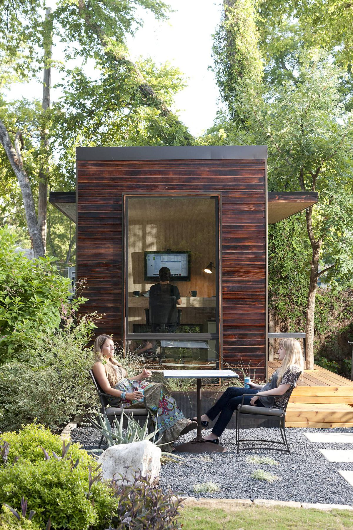 Small and space-savvy backyard home office offers a peaceful working space