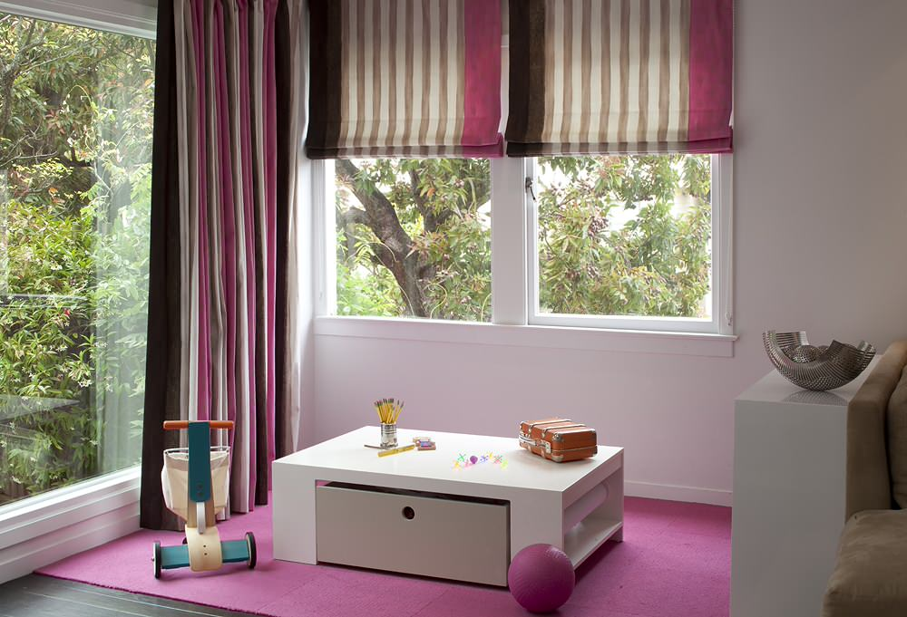 Small desk in the playroom also functions as storage area in the kids' playroom