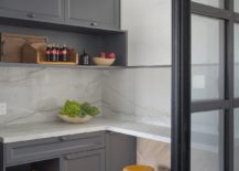 Small-modern-kitchen-in-gray-and-white-with-wooden-floor-95863-217x155