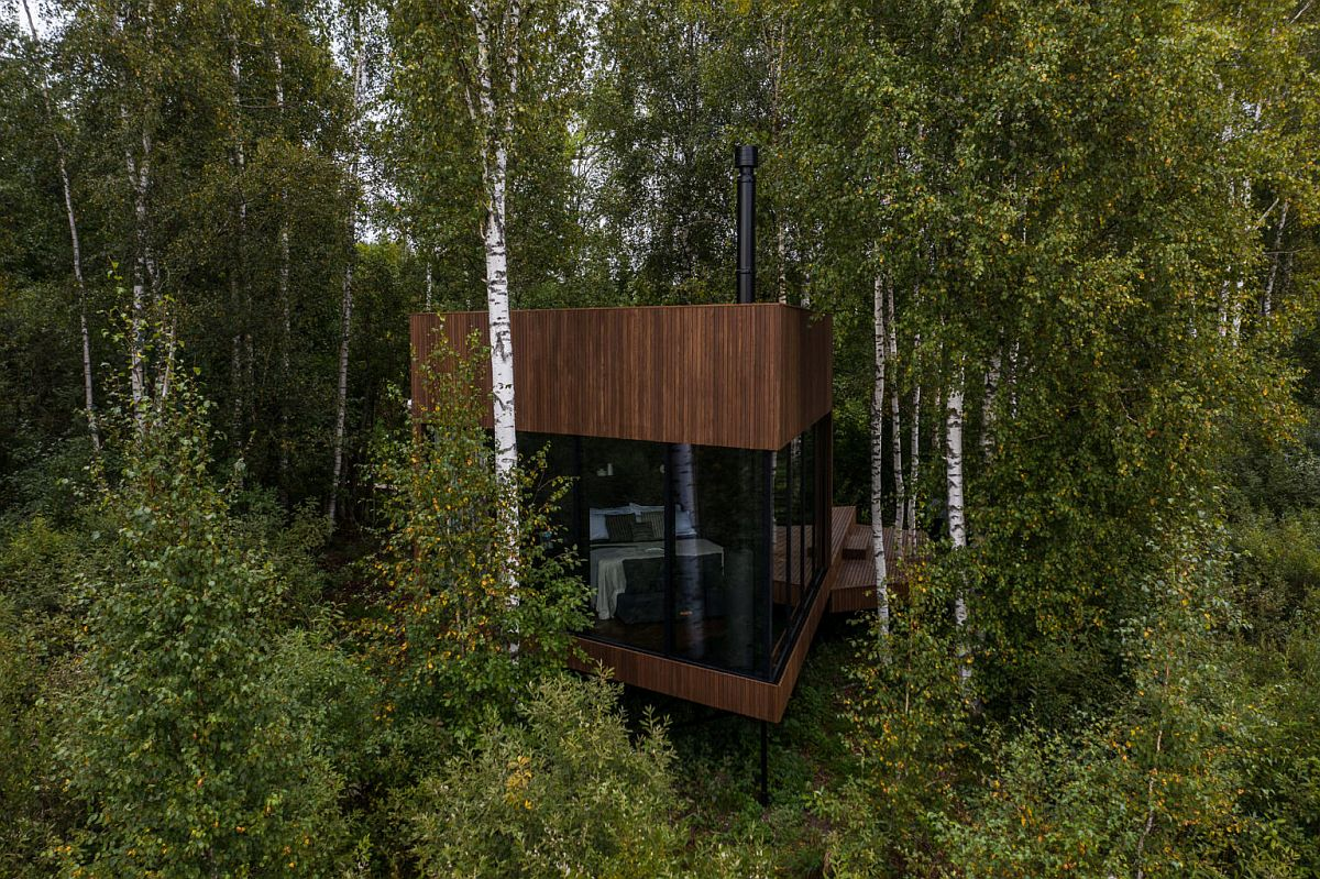 Small-wooden-cabin-with-triangular-edges-and-ample-deck-space-in-the-woods-of-Estonia-60628