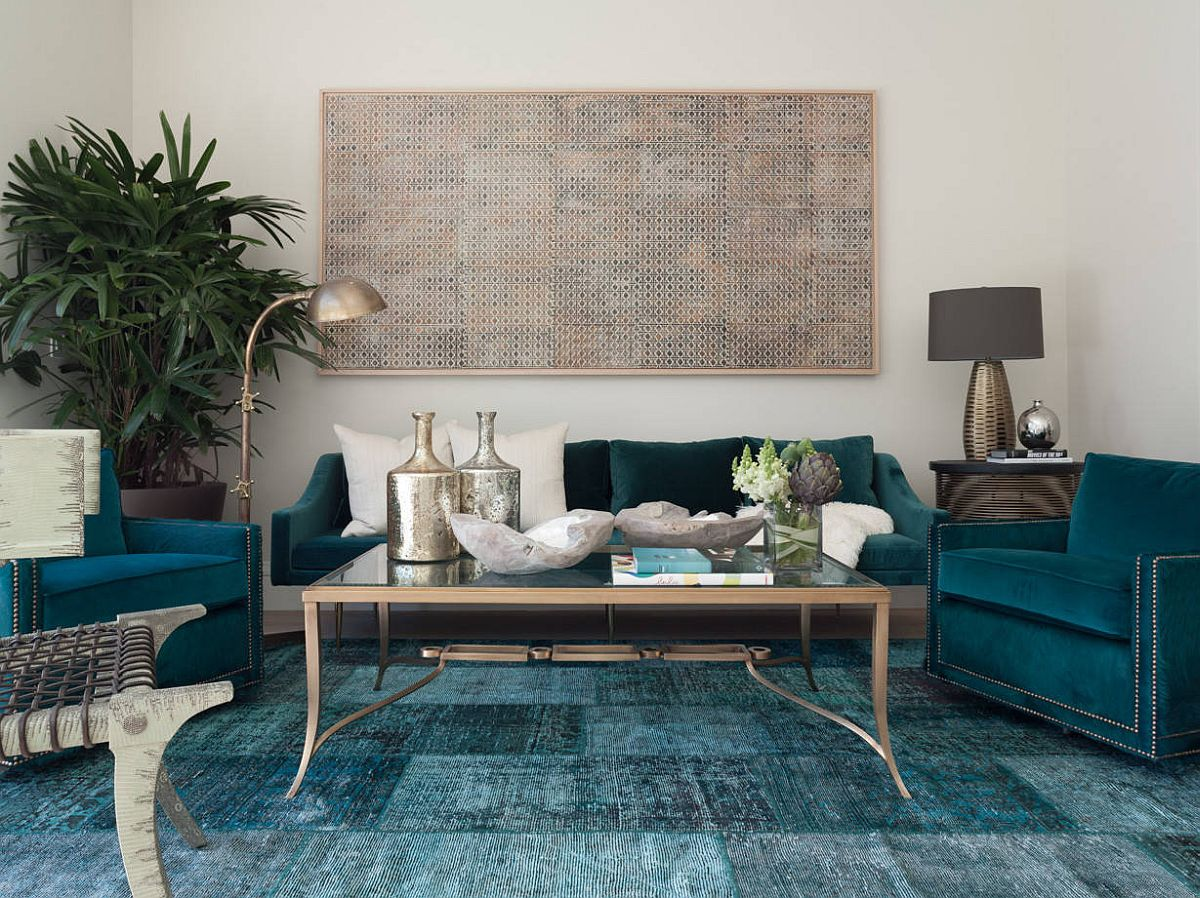 Sofas, rug and other accents add shades of deep blue and teal to the spacious modern living room
