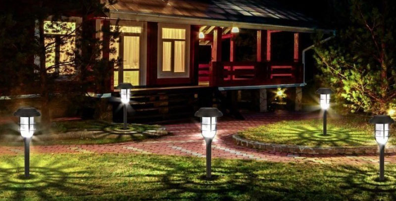 Solar lights turning on at night in front of a house