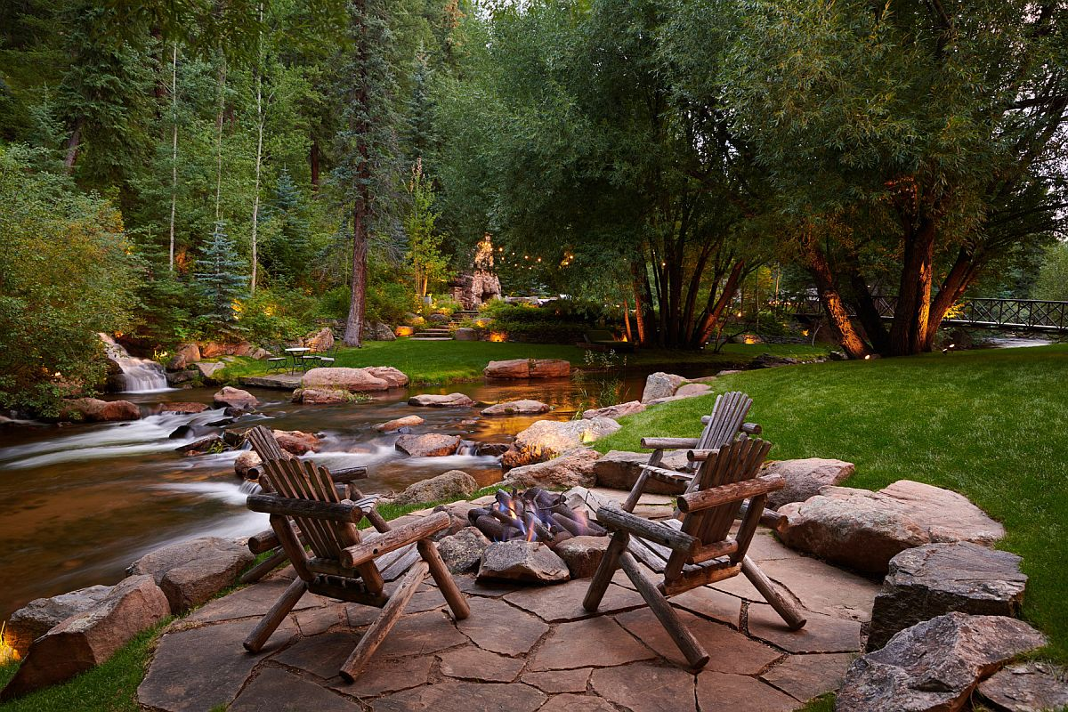 Stunning backyard landcape with natural pond and ample greenery is perfect space to relax