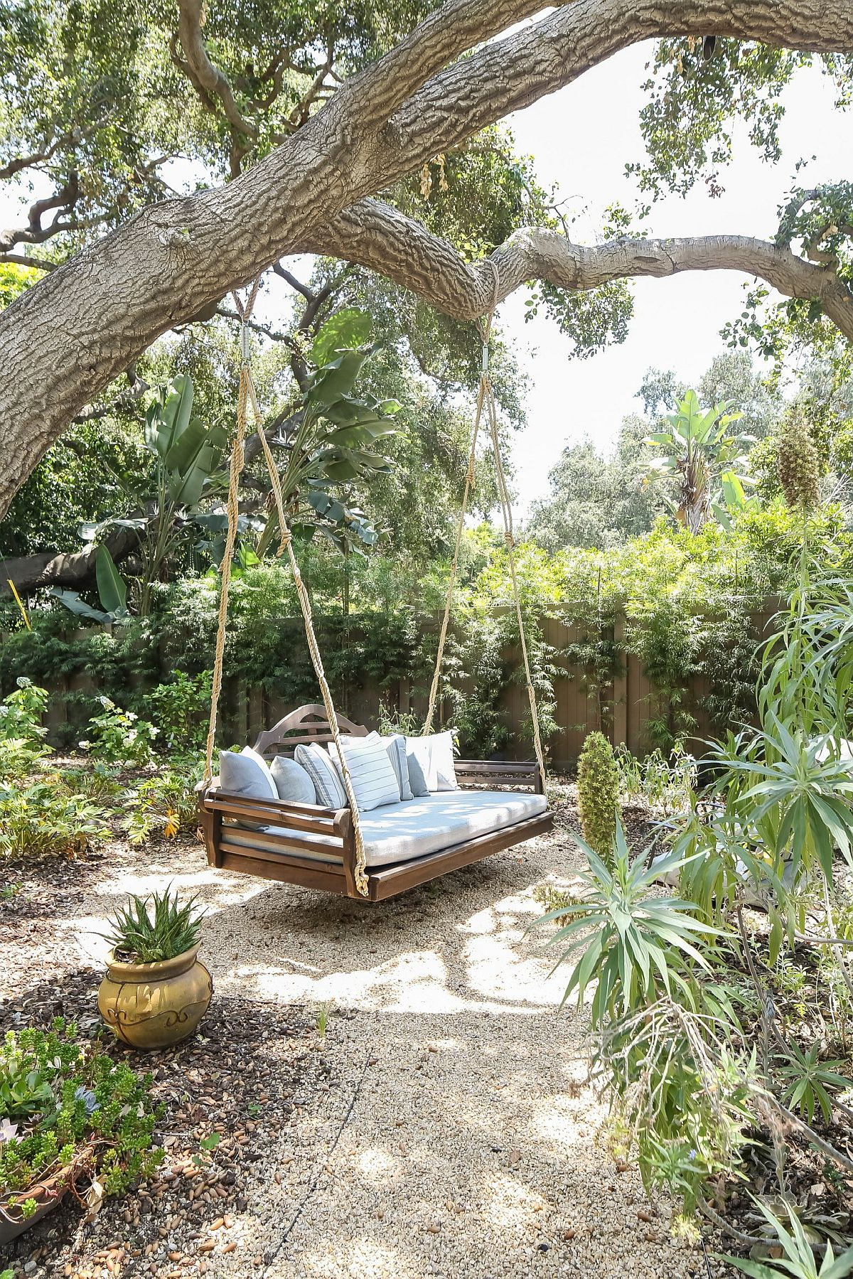 Swing bench in the garden is a great spot to rest in the garden