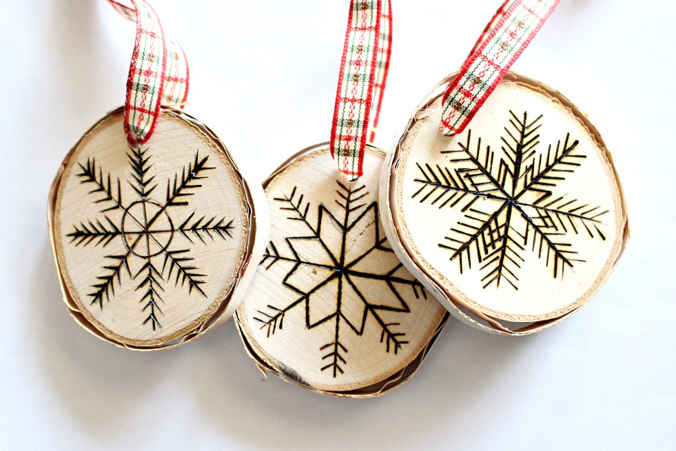 Three carved rounded Christmas ornaments with ribbon