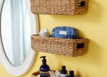 Three wicker baskets on the wall full of things