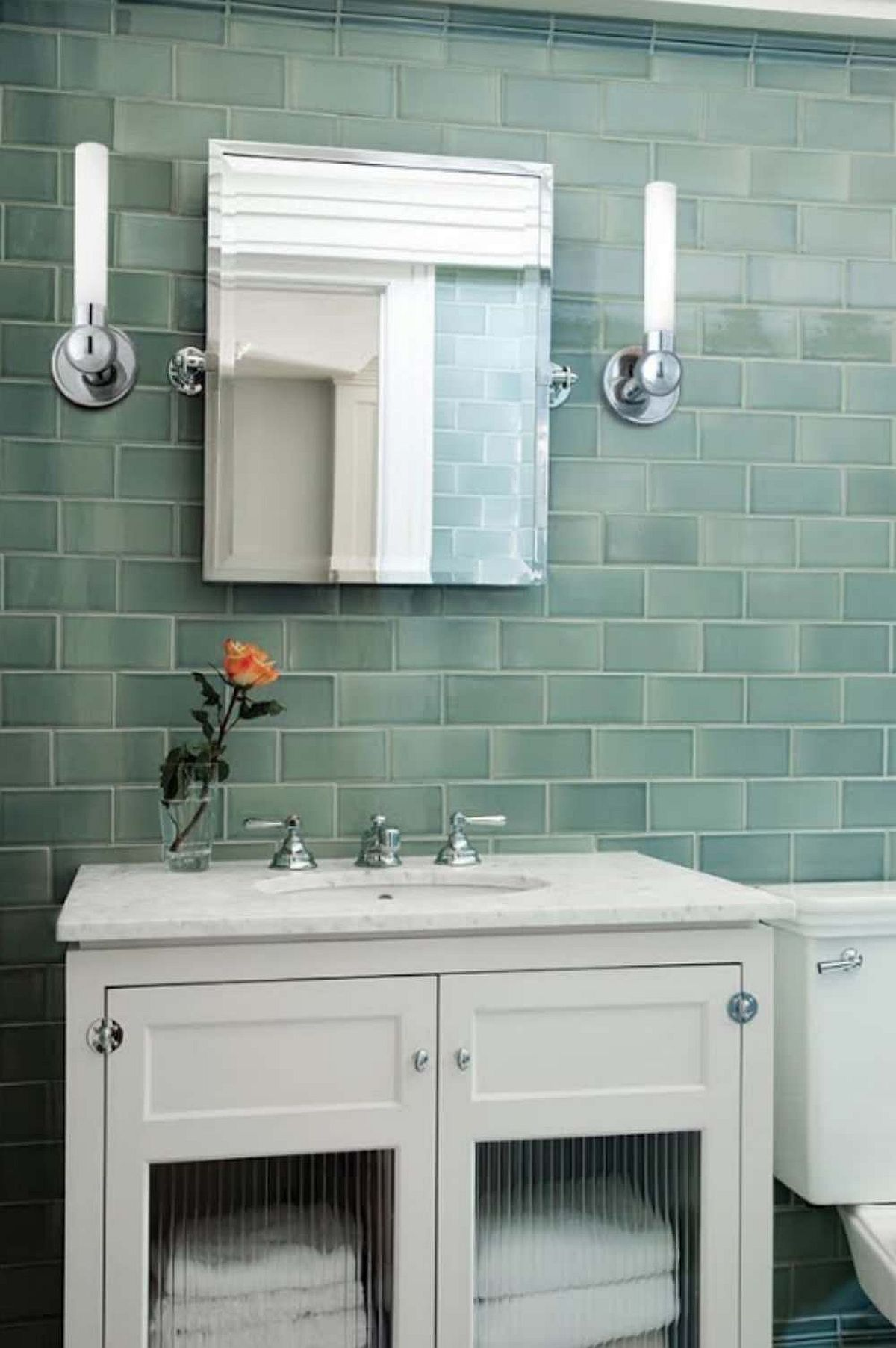 Tiles in green for the contemporary bathroom with white vanity and smart lighting