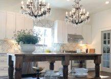 Two chandeliers above a table