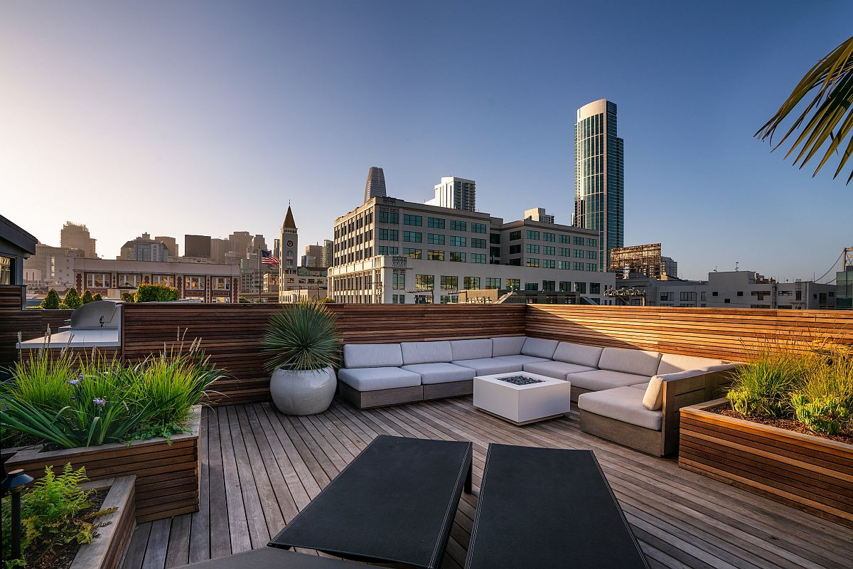Urbane and private rooftop deck of San Francisco home with comfy seating