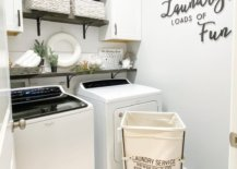 Wall decal and hamper inside laundry room