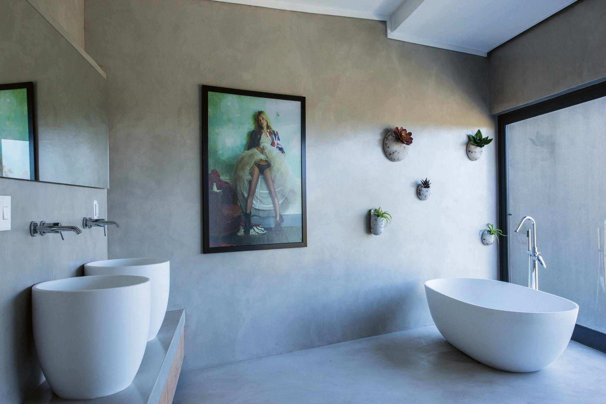 Wall-mounted plants inside the bathroom with polished, spa-inspired look