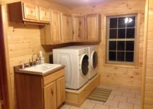 Washer and dryer on a platform beside sink