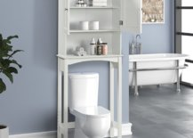White bathroom fixtures in greyish-blue wall