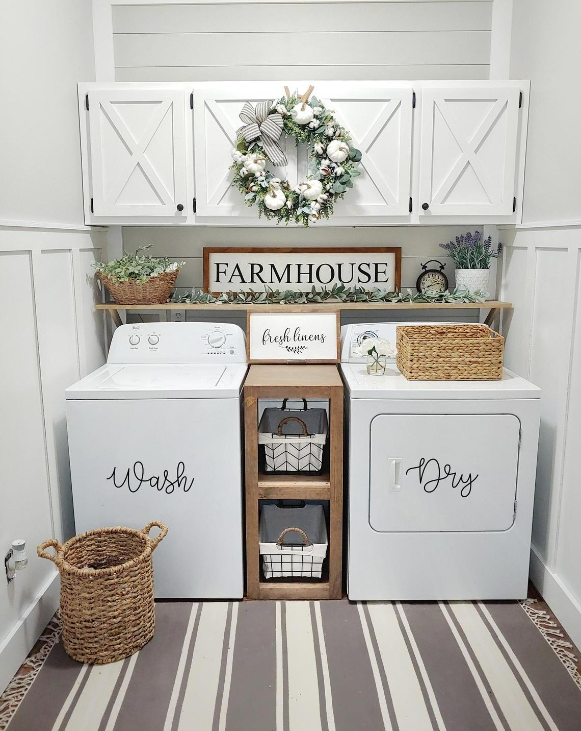 White laundry room with wreath and wicker baskets