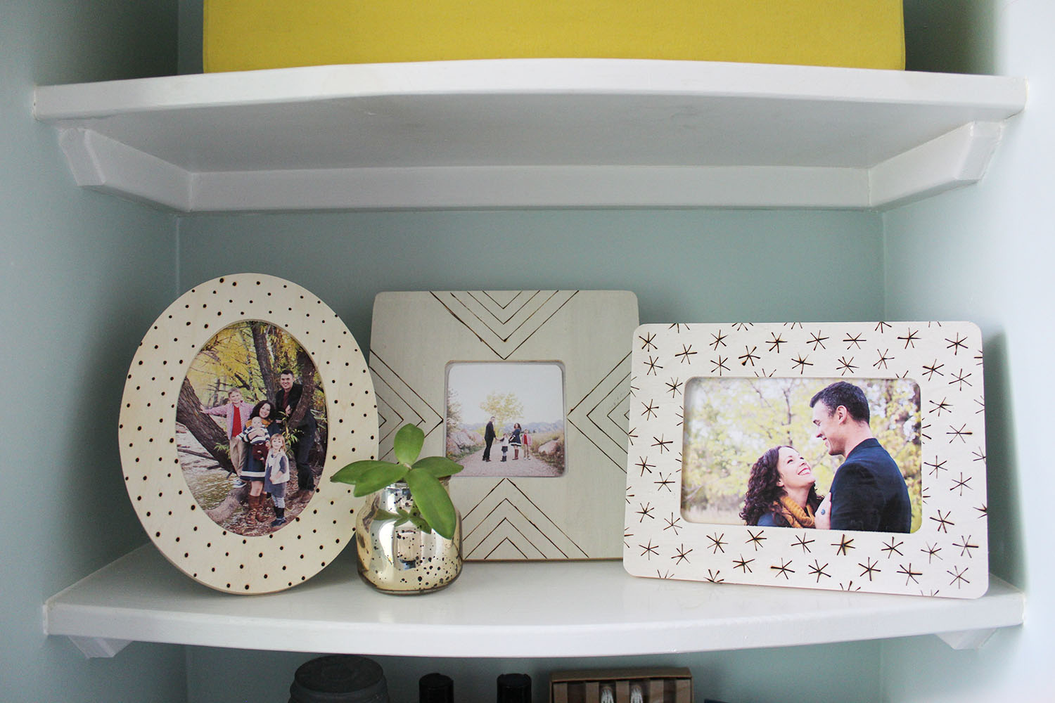Wood burned photo frames in various shapes