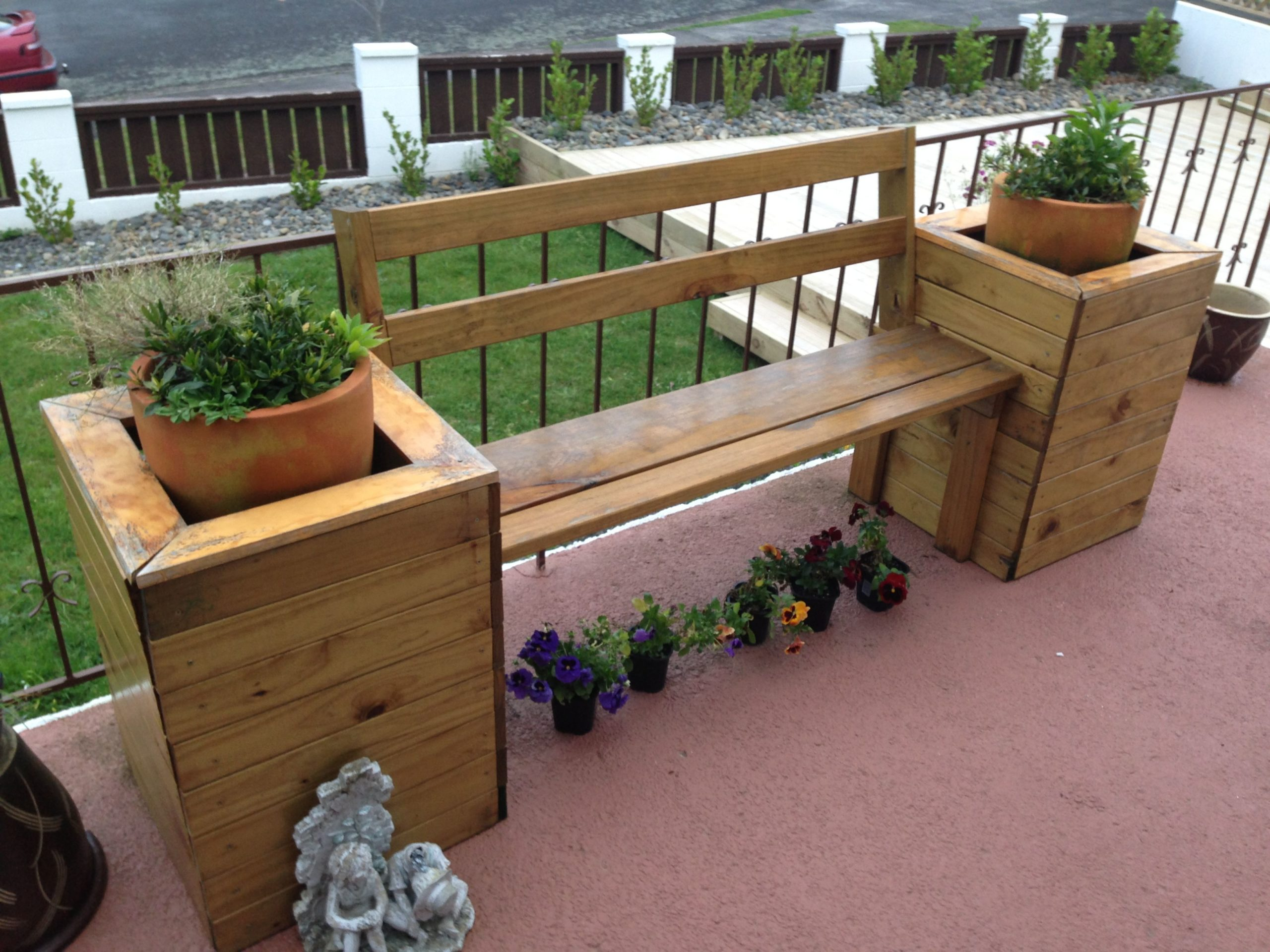 wooden bench with attached planter