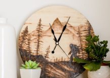 Wooden clock with two potted plants on white vase
