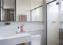 Wooden-flooring-coupled-with-gray-and-white-touches-in-the-small-modern-bathroom-44331-217x155