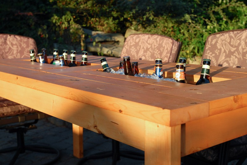 wooden table with built in drink storage