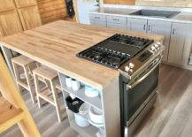 Wooden table with built-in cooking range