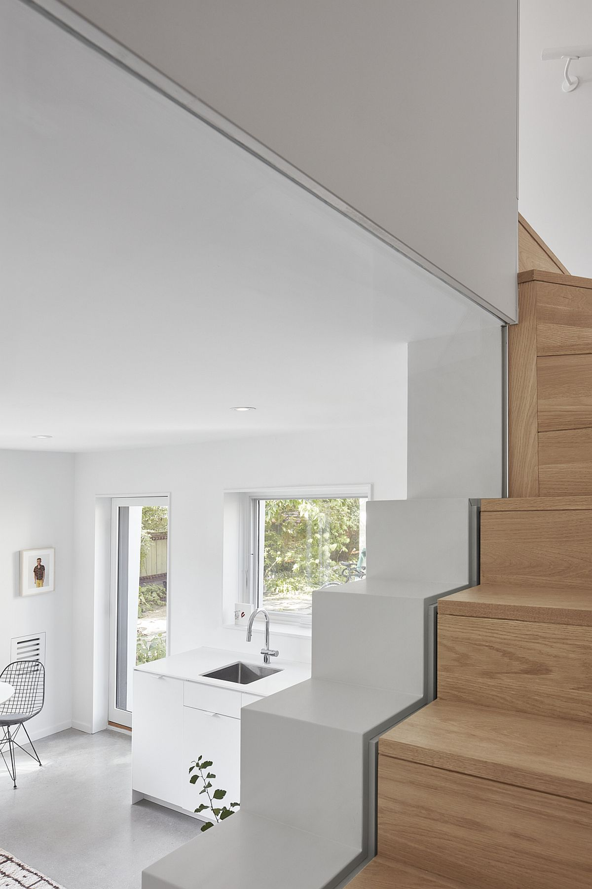 Woodsy staircase leads to the gorgeous upper level with bedrooms