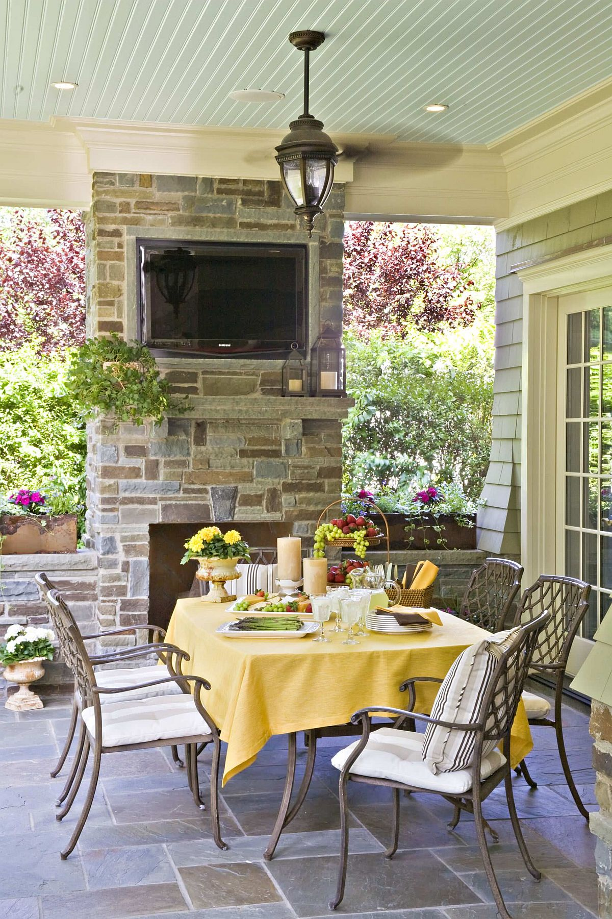 Yellow able cloth along with accents for the outdoor dining table