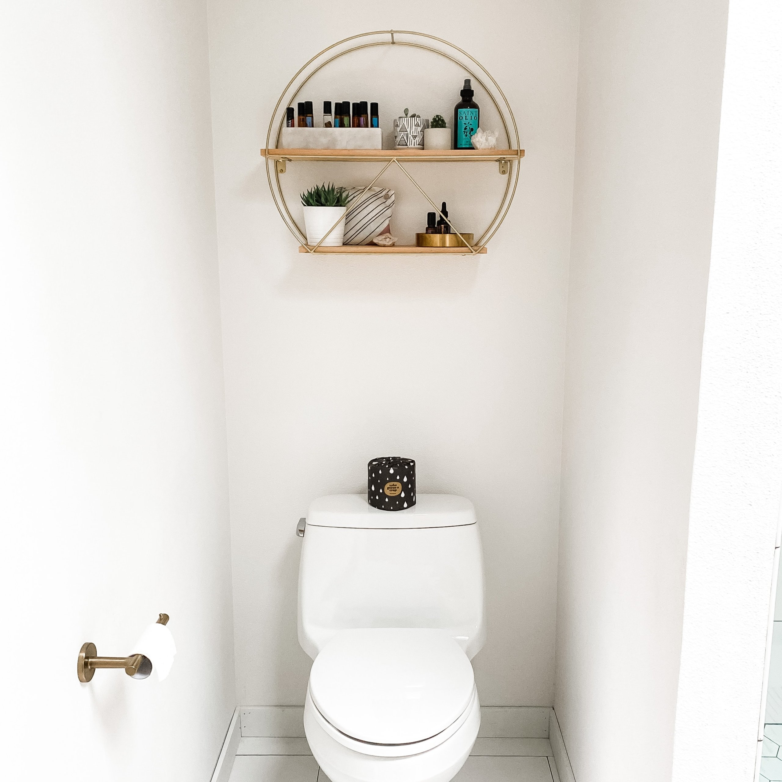 White toilet with black candle on top