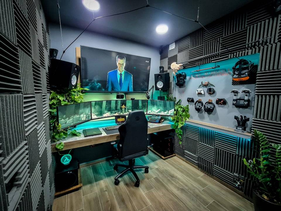 sound proof gaming room with multiple screens and blue lighting