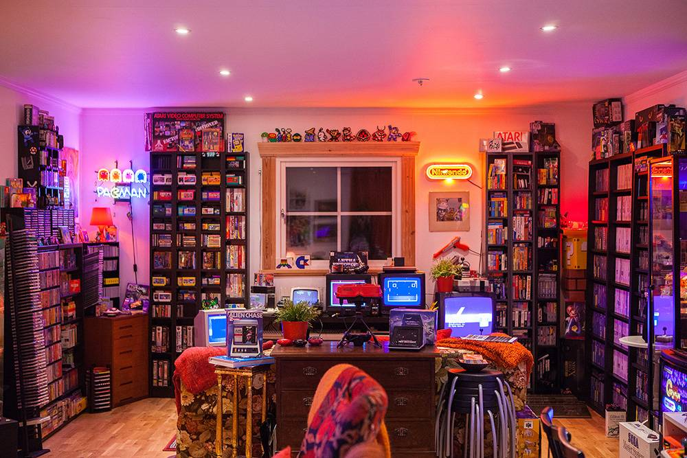 video game room and extensive shelving for games
