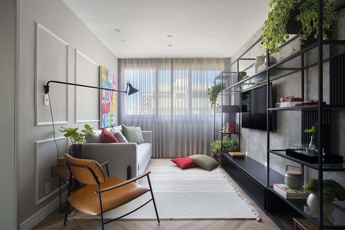 Space-savvy and stylish living area with greenery, industrial shevles and walls of gray