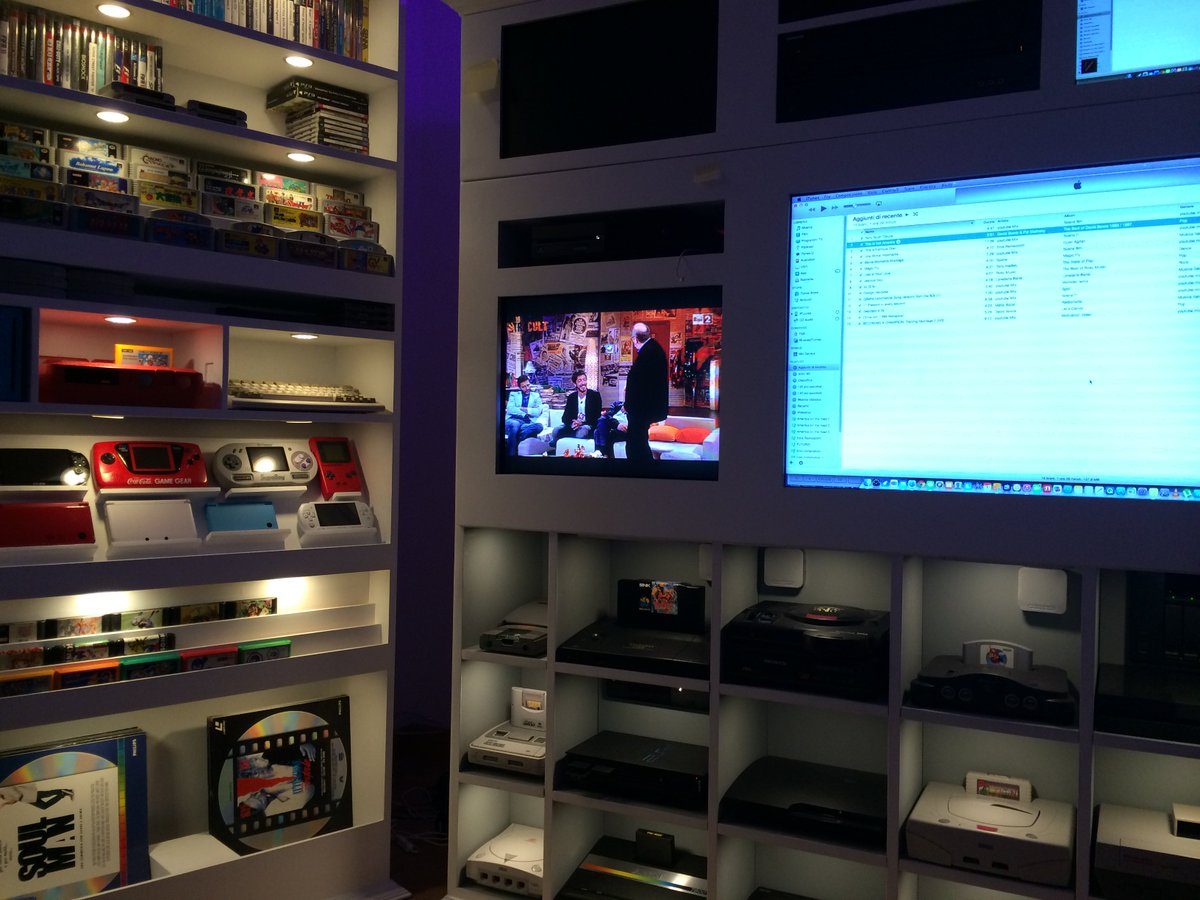 video game shelf featured beside television