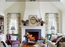 Adding-a-bit-of-color-and-cheerful-zest-to-the-double-height-living-space-in-white-23380-217x155
