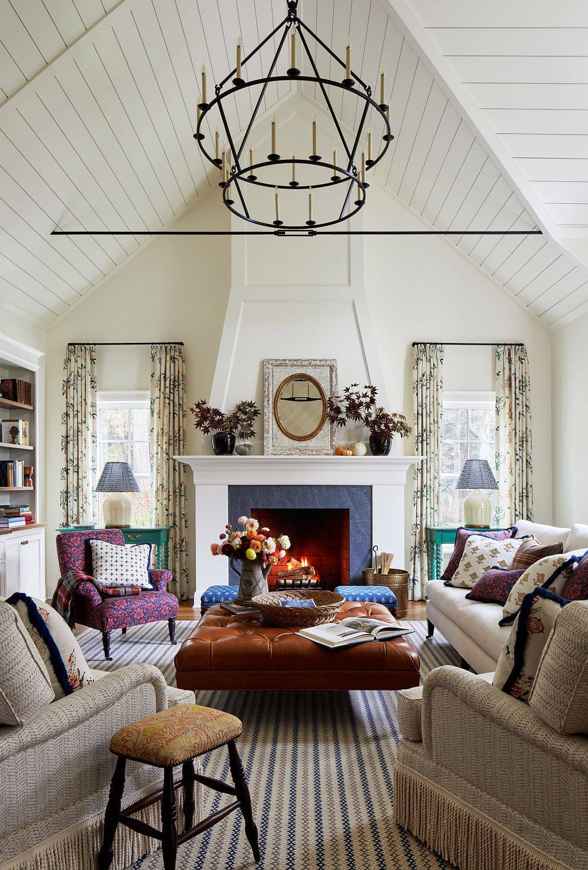 Adding-a-bit-of-color-and-cheerful-zest-to-the-double-height-living-space-in-white-23380