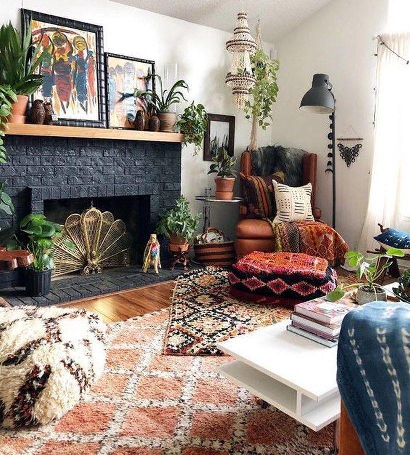 boho living room setup with black fireplace