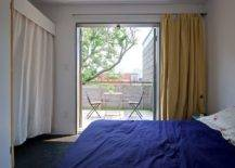 Bedroom-doors-slide-open-to-connect-it-with-the-small-balcony-outside-26435-217x155