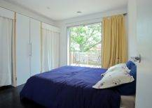 Bedroom-in-white-with-sliding-glass-doors-accentuated-by-pops-of-yellow-and-blue-76410-217x155