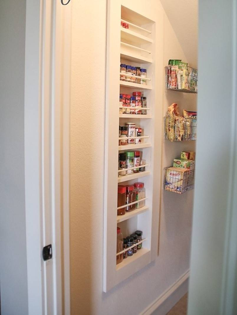 Built-in spice rack in white wall