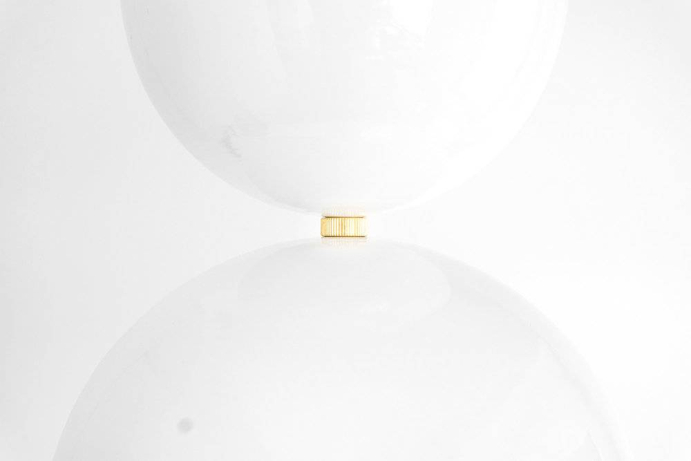 Closer look at the contemporary planter light in white with metallic tinge